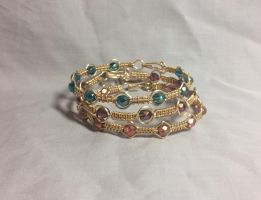wire wrapped cotton candy colors stacking bangles by ACrowsCollection