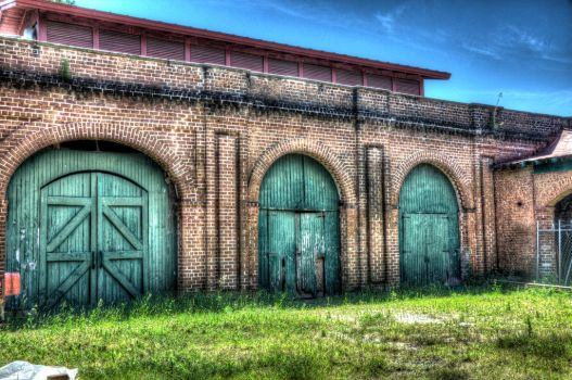 Railroad building with green doors by PearsPhotography