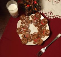 A plate of cute and soft gingerbread men by SugarcubeCherry