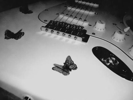 Butterfly guitar by MaladjustedHeart