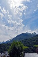 0797 Clouds and Sun over the mountain by RealMantis