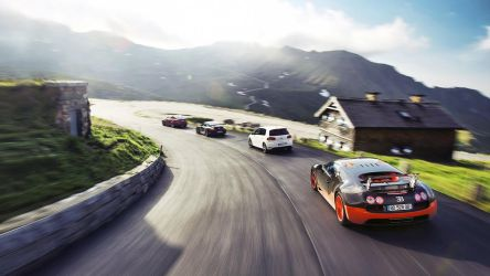 Luxury Sports Cars Racing On Rural Paved Road by ROGUE-RATTLESNAKE