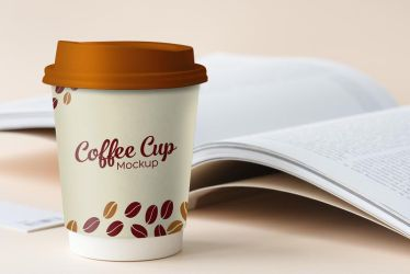 Free Small Paper Coffee Cup Mockup PSD by Designbolts