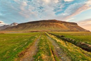 Iceland Sunset Tractor Trail by somadjinn