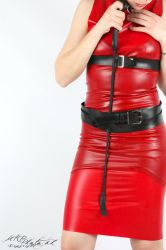 Red latex dress and a whip by LatexSquirrel
