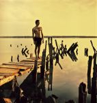 At the evening on the old pier by psychiatrique