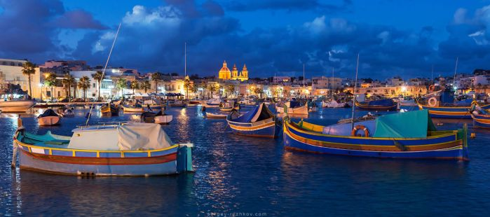 Panorama of night Marsaxlokk, Malta by Sergey-Ryzhkov
