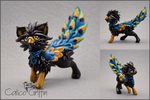 Regio the Peacock Griffin - polymer clay by CalicoGriffin