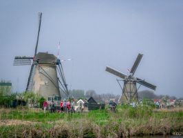 two windmills in Holland by Rikitza