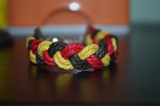 yellow red black braided bracelet by ghelalala
