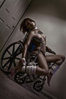 trying out the wheelchair by SweetAddiction86