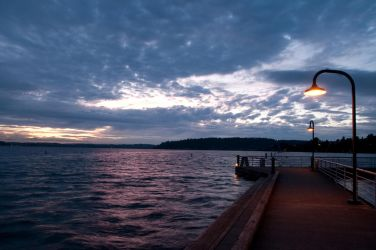 Dark Pier after Sunset with Lampposts by happeningstock