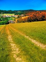 Path down and up to the village center by patrickjobst