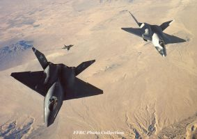 Both YF-23 prototypes  and a YF-22 chasing by fighterman35