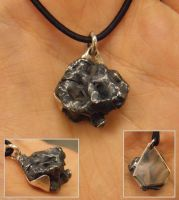 Meteorite iron pendant by fairyfrog