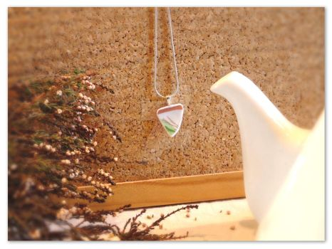 Unique triangle-shaped broken china pendant by rouages