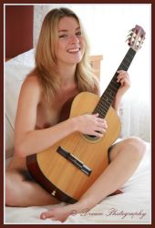Happy guitarist by DreamPhotographySyd