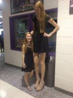 Tall woman with sister by lowerrider