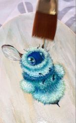 Varnishing this teal bee by camilladerrico