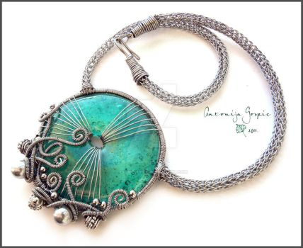 Turquoise glass donut necklace by Faeriedivine