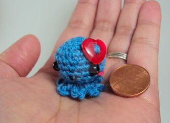 Mini Amigurumi Octopus with Red Heart Button by altearithe