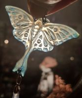 Luna Moth pendant in transluscent horn by fairyfrog