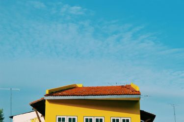 A yellow house and a red roof by lilianadc