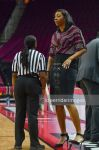 Tall basketball coach with tiny referee by lowerrider