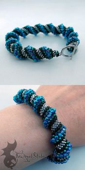 Blue And Silver Cellini Spiral Bracelet by TheWingedShadow