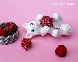 White kitty playing with yarn sculpture by SculptedPups