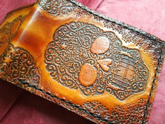 Day of the dead skull leather wallet close up by Bubblypies