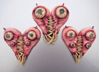 Interlocking meat heart pendants by dogzillalives