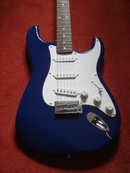 Chipped Strat by TornIntegral