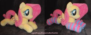 Laying Fluttershy by agatrix