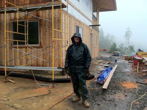 Me in my rain suit working on siding by Chicks82