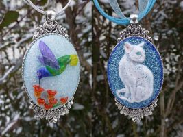 Hummingbird and Cat-painted pendants by Actlikenaturedoes