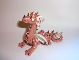 Seashell Beach Dragon by ByToothAndClaw