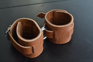 Brown Leather cuffs parallel configuration by Plasma-dragon