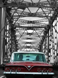 Red car on harbour bridge by crystalclare