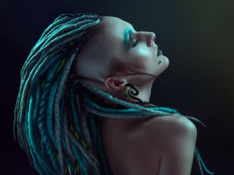 Pretty girl with dreadlocks posing in studio by Black-Bl00d