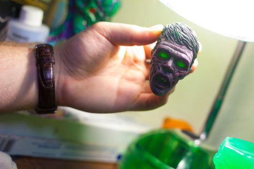 Translucent Green zombie head under a light. by misfitjake
