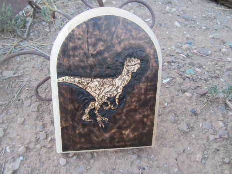 Utahraptor burned into wood by jpnmaynard