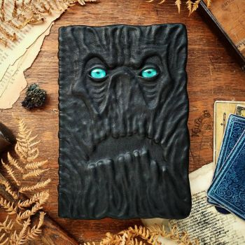 Necronomicon with turquoise eyes! by MilleCuirs