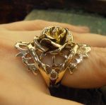 Rose ring with anchors and thorn wings by fairyfrog