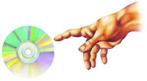 Hand points a cd by volioti