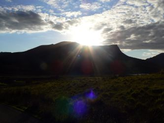A mountain. And the sun by Clouty