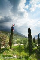 cypresses and flags (Roadtrip to Tuscany) by mystic-darkness