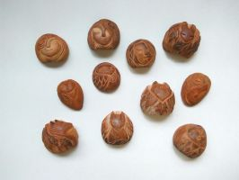 Avocado seed carvings by sandara