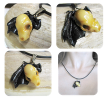 bat skull and wing pendant by BadgersBakery