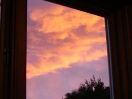 Flaming sky by the window by Zazou8